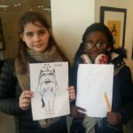 2_Girls_completed_drawing_of_black_supershero_character