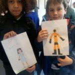 2_boys_completes_black_supershero_drawing