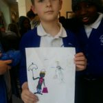 boy_completes_his_black_supershero_drawing